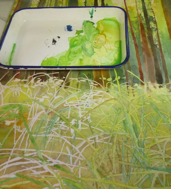 and painting the grass with a mix of green, yellow, blue, brown