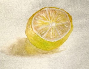 Painting a lemon from life with watercolors