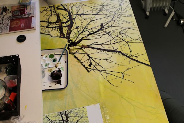 painting the tree with India ink and liquid acrylic and spraying with alcohol