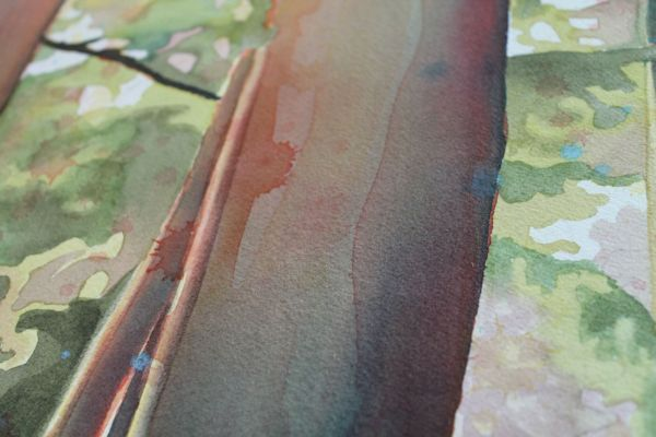 close up of drips and textures on the watercolor forest painting
