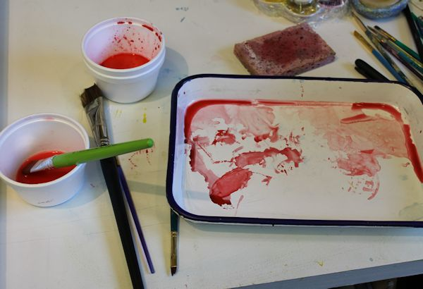 red layer of watercolor to paint the tree trunks