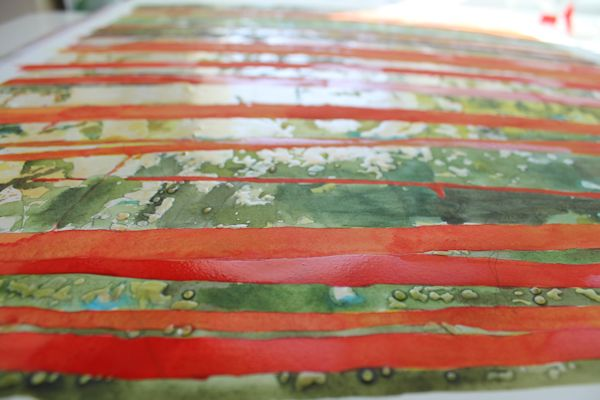red layer of watercolor to paint trees
