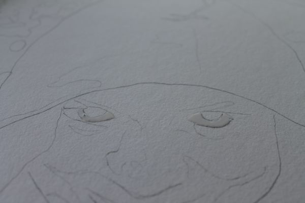 The white of the eyes have been preserved with masking fluid.