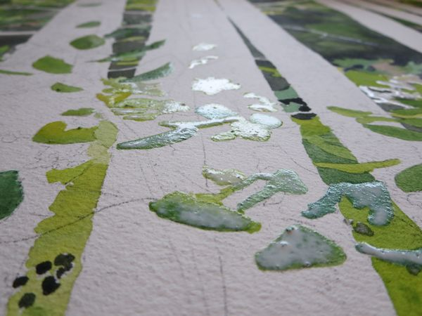 masking fluid over watercolor on the leaves that are on the trunks