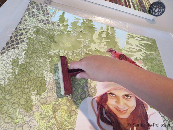 use a brayer to remove air bubbles between the watercolor painting and the board.