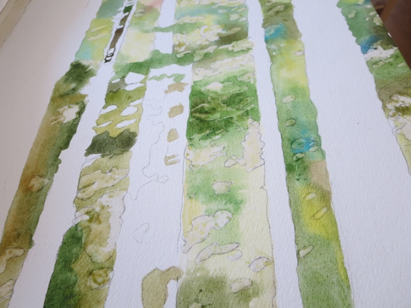 painting wet into wet with watercolor letting color mix on the paper