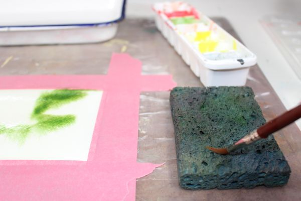 You can use a wet sponge on the side of your painting to clean and dry your brush in between colors.