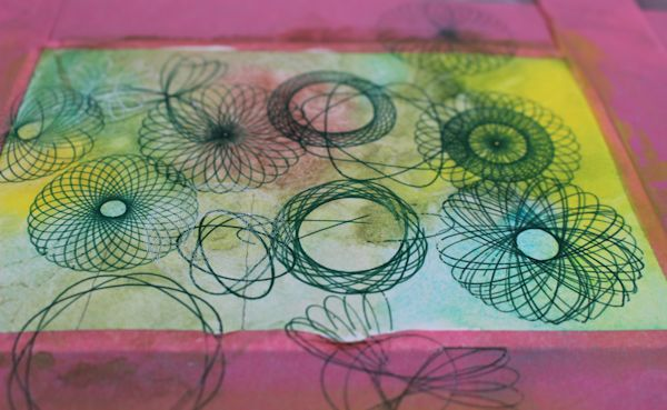 adding spirograph patterns to the watercolor background