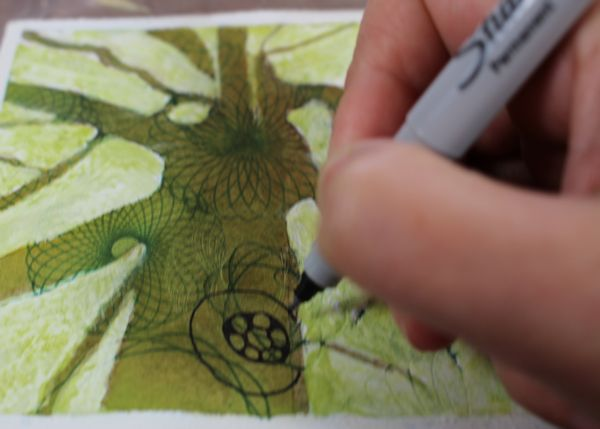drawing patterns with sharpies on the tree