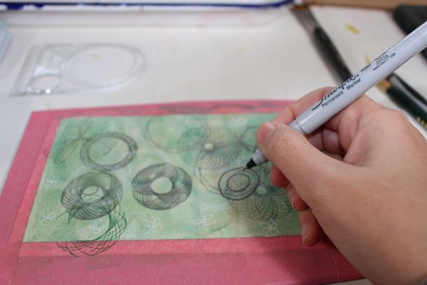 Spirograph drawing on your postcardbackground