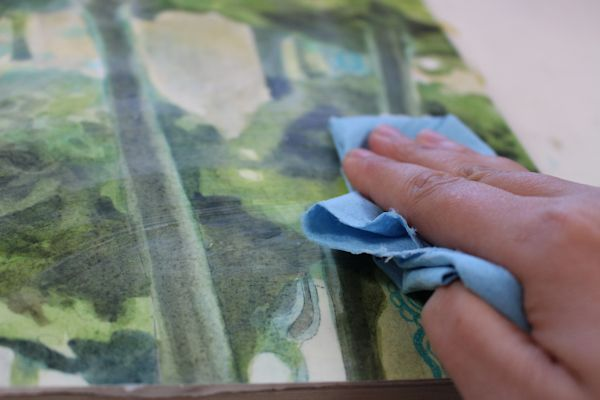 applying the dorland's wax medium on watercolor