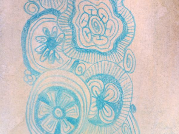 zentangles flowers with colored pencil on watercolor paper