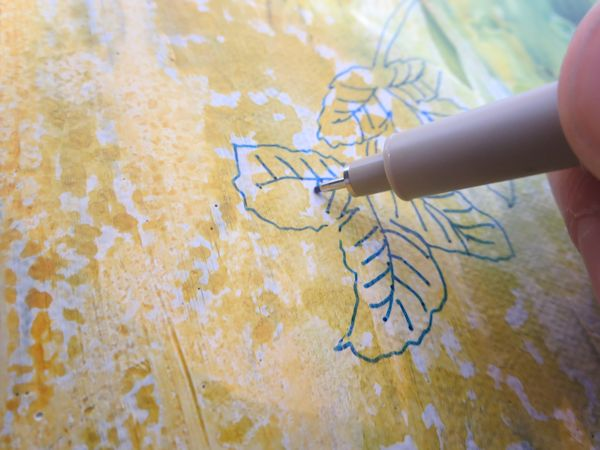 drawing leaves with a marker on canvas