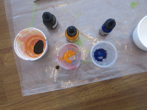 prepare a few solutions of fluid acrylic inks, water and gel medium