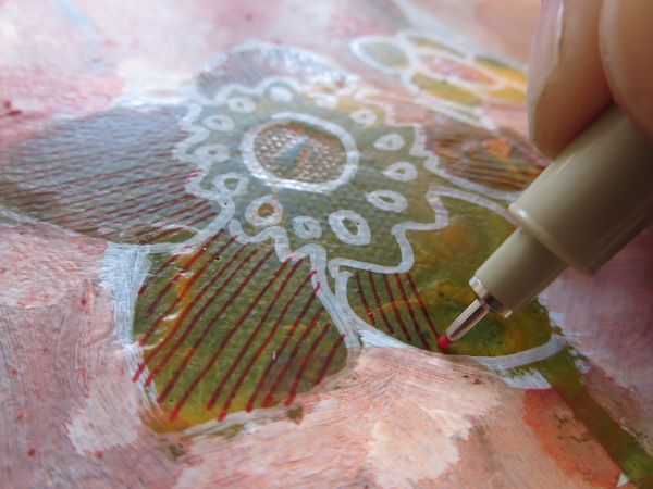 drawing stripes in the flower petals with marker on canvas