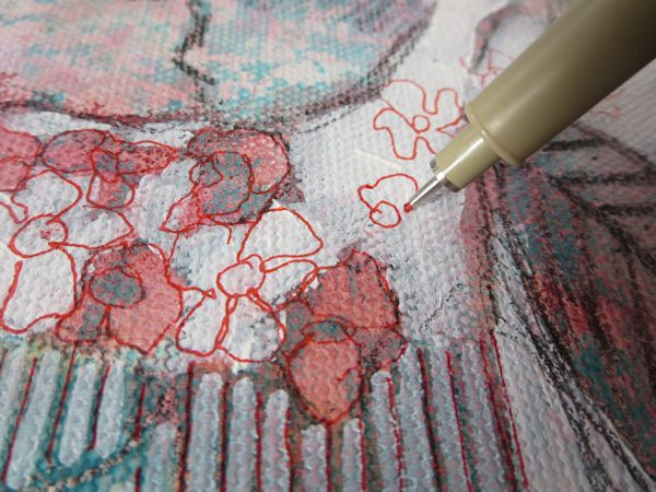 drawing flower shapes with a red Sakura marker on canvas