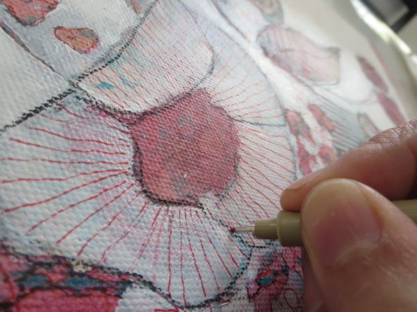 adding patterns to the flowers with a marker on canvas