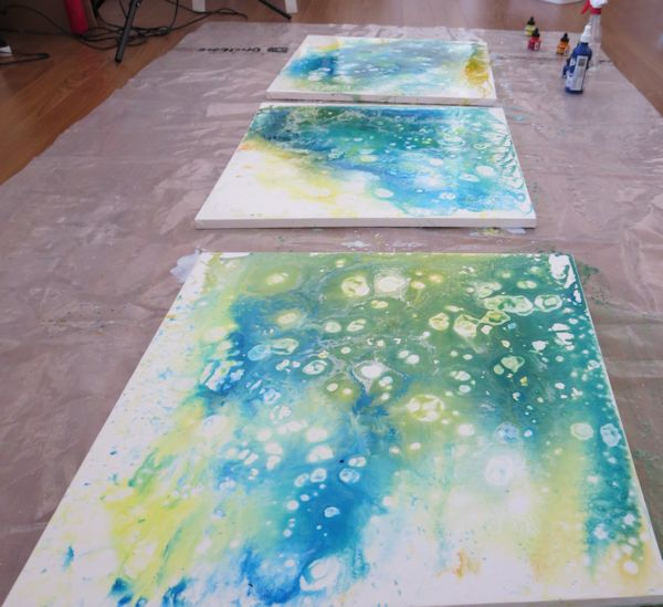A series of 3 paintings with abstract backgrounds in acrylic inks