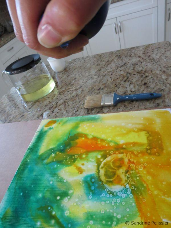 adding visual texture with alcohol on top of an acrylic ink wash