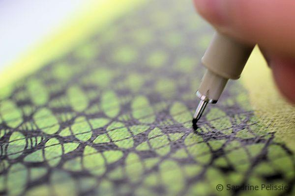 using markers to draw patterns on top of acrylic paint
