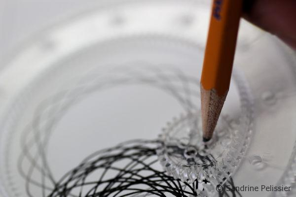 using a pencil with Spirograph