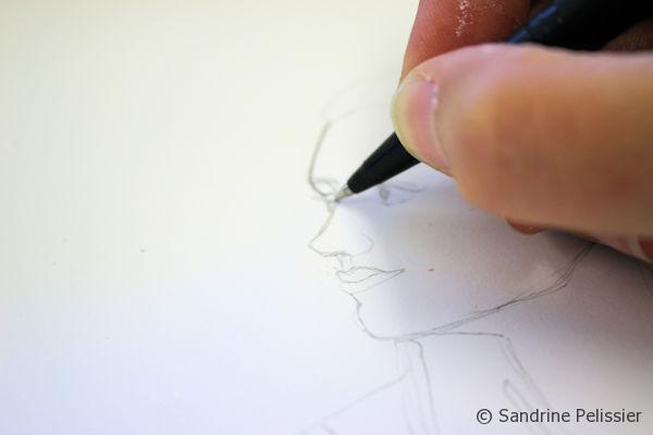 can go over it with a ball point pen, dipping pen, marker or a fine liner.