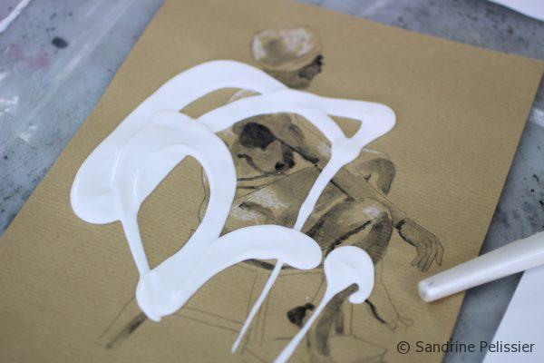 applying clear gesso on top of drawings