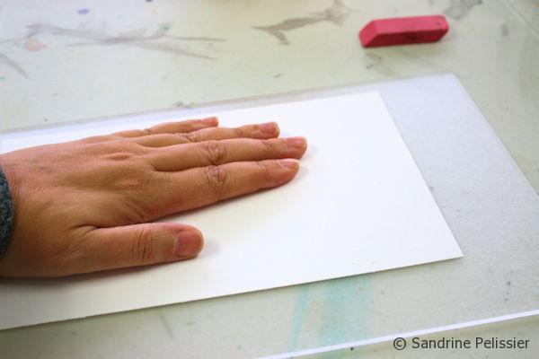 Apply the wet sheet of paper on top of your drawing.