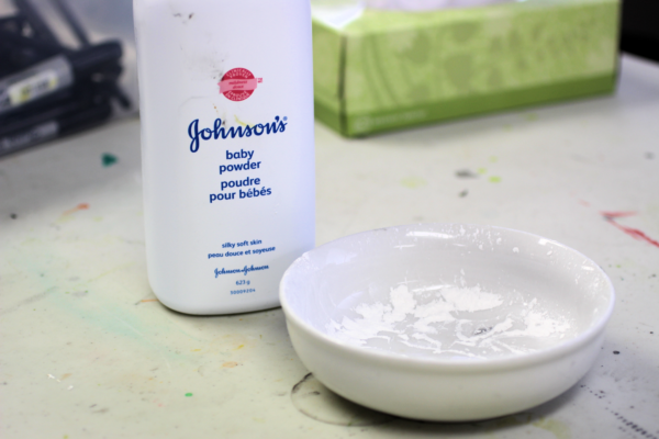 a bowl of baby powder works great to avoid transferring ink on your clean paper