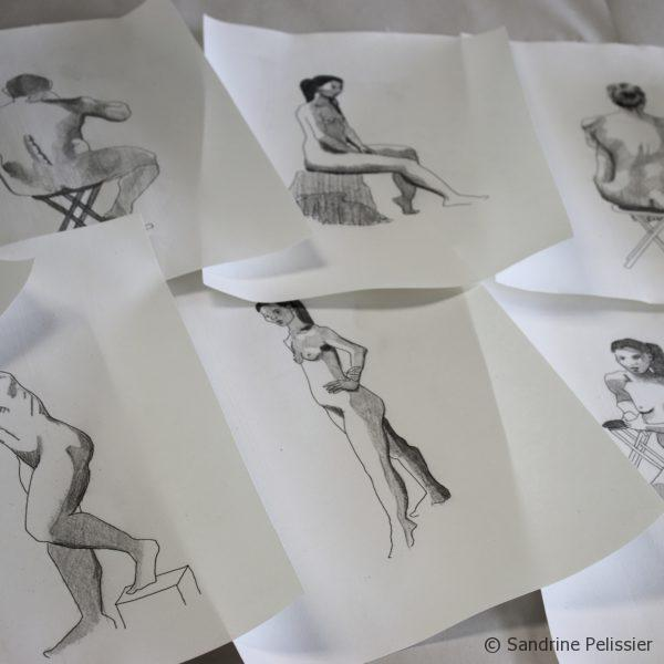 selecting some life drawings to paint on top
